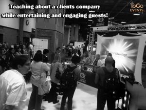 teaching about a clients services at a trade show activation