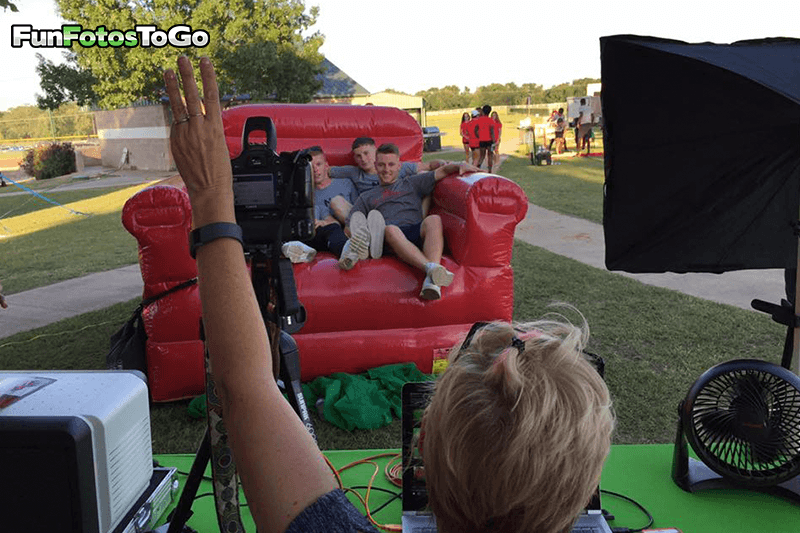Taking Photos in the big red chair