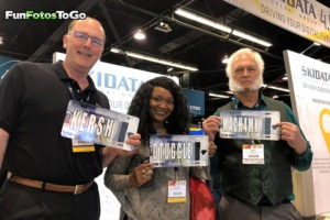 Anchorage Alaska group with custom license plates at trade show