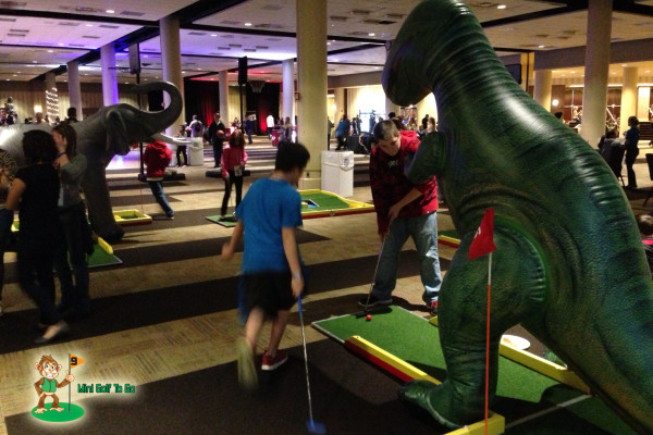 Mini Golf To Go - Kids playing Trex Hole with Elephant in BG